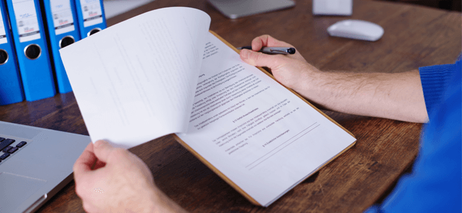 What is Vendor Management Explained by a Contract in a Man's Hand