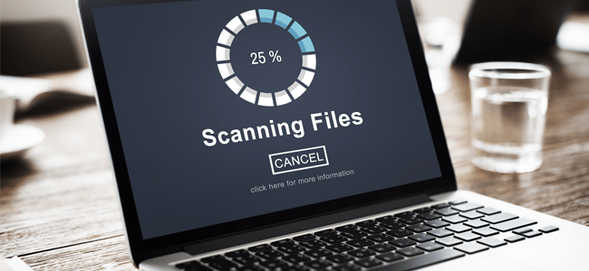 Computer Scanning Files to Secure Company Data