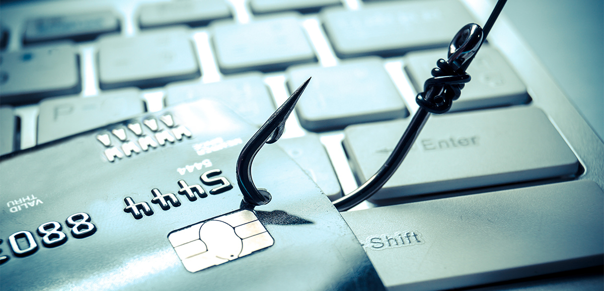 Fishing Hook Catching a Credit Card to Illustrate Phishing and How Securing Company Data is Important